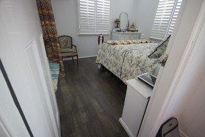 unpolished wooden floor in the bedroom