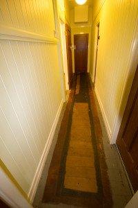 Hallway stained wooden floor
